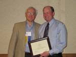 Robert Havlik, MD presents recognition to Mike Greene, KLS-Martin for support to ASCFS.
